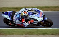 MotoGP points leader and Yamaha rider Jorge Lorenzo of Spain, seen here during the second free practice of the MotoGP Japanese Grand Prix at the Twin Ring Motegi circuit in Motegi on October 12. Lorenzo stunned his archrival Dani Pedrosa in a record-shattering run in his final lap of qualifying Saturday to clinch pole position for the Japanese Grand Prix
