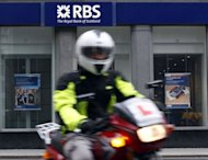 State-rescued Royal Bank of Scotland on Friday posted a third-quarter net loss of 1.384 billion on massive accounting charges and warned it would likely face fines over the Libor rate-rigging scandal