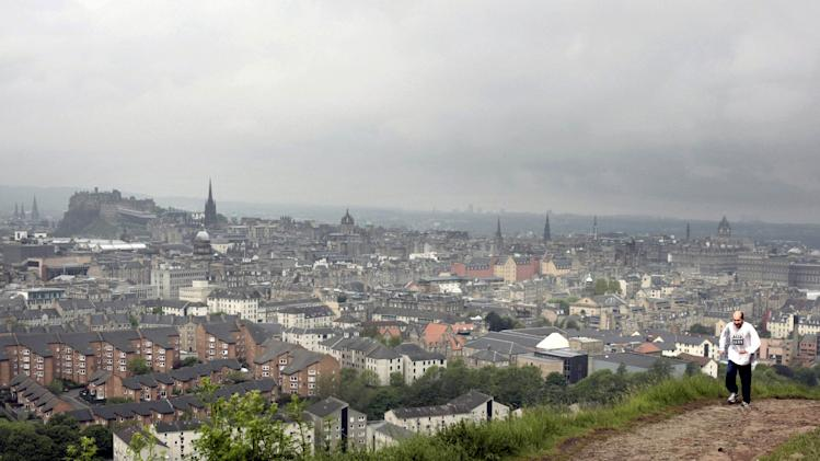 A general view of the city of Edinburgh, with Edinburgh Castle in the background at left, as the number of confirmed cases of Legionnaires' disease following a deadly outbreak rises Thursday June 7, 2012. Health officials in Scotland say there are now 51 confirmed cases of Legionnaires' disease in an outbreak that has left one man dead. Scottish Health Secretary Nicola Sturgeon reported the latest number of cases in the Edinburgh-area outbreak to Scotland's Parliament on Thursday.    (AP Photo/David Cheskin/PA Wire) UNITED KINGDOM OUT