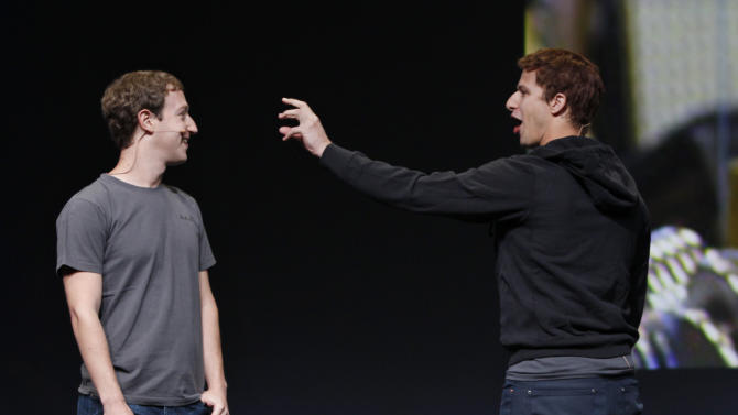 Comedian Adam Samberg, right, of Saturday Night Live, gestures at Facebook CEO Mark Zuckerberg, left, during the f/8 conference in San Francisco, Thursday, Sept. 22, 2011. (AP Photo/Paul Sakuma)