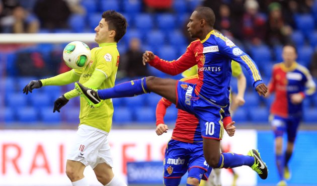 FC Basel's Yapi challenges Krstic of FC Thun during their Swiss Super League soccer match in Basel