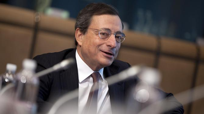 European Central Bank President Mario Draghi speaks during a meeting of the Macroeconomic Dialogue Group prior to a meeting of the eurogroup ministers in Brussels on Monday, March 4, 2013. The eurogroup finance ministers are set to discuss details of a bailout for cash-strapped Cyprus, further steps of assistance for Portugal and Ireland as well as the controversial issue of direct banking recapitalizations through Europe's permanent rescue fund. (AP Photo/Virginia Mayo)