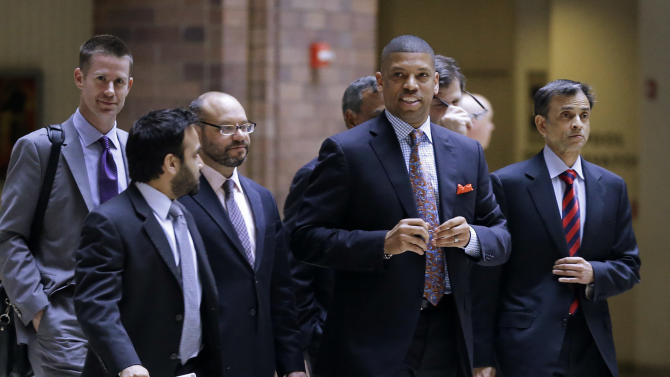 Sacramento, Calif., Mayor Kevin Johnson, right front, a former NBA basketball player, walks out of an NBA Board of Governors meeting during a break Wednesday, May 15, 2013, in Dallas. The meeting is an effort to resolve the five-month-long struggle over the future of the Sacramento Kings. The board's tasks: Decide whether the team should move to Seattle or stay in Sacramento, and then figure out who should own the franchise. (AP Photo/Tony Gutierrez)