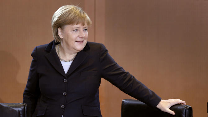 German Chancellor Angela Merkel arrives for the weekly cabinet meeting at the chancellery in Berlin, Germany, Thursday, Dec. 6, 2012. (AP Photo/Michael Sohn)