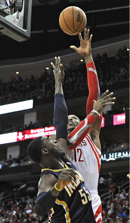 Houston Rockets' Dwight Howard (12) shoots for two points against Indiana Pacers' Roy Hibbert (55) in the first half of an NBA basketball game on Friday, March 7, 2014, in Houston
