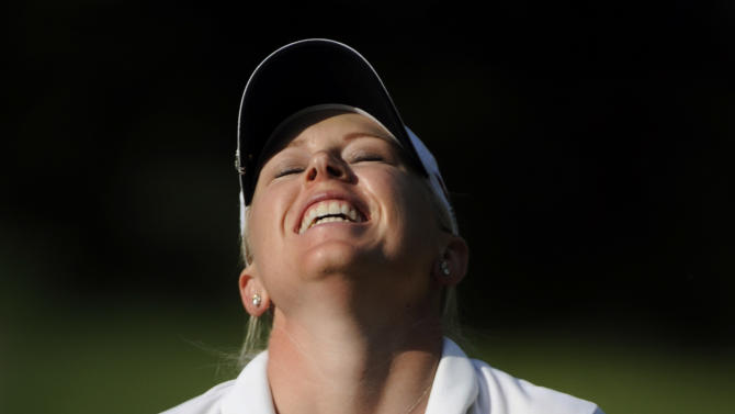 Morgan Pressel reacts after a putt does not go in on hole 13 during the final round of the LPGA Championship golf tournament at Locust Hill Country Club in Pittsford, N.Y. on Sunday June 9, 2013. (AP Photo/Gary Wiepert)