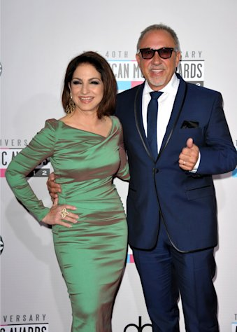 FILE - The Nov. 18, 2012 file photo shows singer Gloria Estefan, left, and Emilio Estefan, Jr. at the 40th Anniversary American Music Awards in Los Angeles. Gloria Estefan and her husband Emilio Estefan are hoping to develop a stage musical about their lives. The duo on Tuesday announced that they've also teamed up with the Nederlander Organization to try to take the show to Broadway. (Photo by John Shearer/Invision/AP, file)