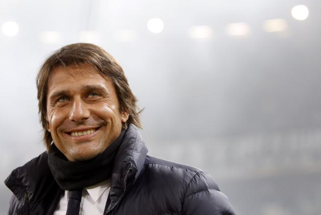 Juventus' coach Conte smiles before the match against Fiorentina in their Europa League round of 16 first leg soccer match at the Juventus stadium in Turin