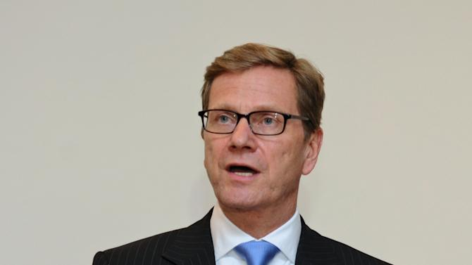 German Foreign Minister Guido Westerwelle speaks to the media after a meeting with his Turkish counterpart Ahmet Davutoglu, unseen, during a forum in Istanbul, Turkey, Saturday, Oct. 13, 2012. Turkey's prime minister sharply criticized the U.N. Security Council on Saturday for its failure to agree on decisive steps to end the 19-month civil war in Syria.(AP Photo)