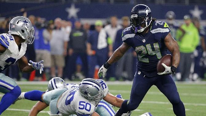 FILE - In a Sunday, Nov. 1, 2015 file photo, Seattle Seahawks running back Marshawn Lynch (24) breaks through a tackle-attempt by Dallas Cowboys' Sean Lee (50) as Cowboys Byron Jones, left, comes over to help on the running play in the second half of an NFL football game, in Arlington, Texas. Lynch, the mercurial Seattle Seahawks running back, sent a tweet during the fourth quarter of Sunday's Super Bowl with a pair of cleats hanging from a power or telephone line, along with an emoji depicting a peace sign. It certainly wasn't a definitive statement that Lynch is ready to call it a career, but it would fit with a mounting stack of evidence that the bruising running back is ready to move on from football. (AP Photo/Brandon Wade, File)