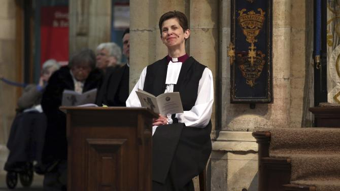 Reverend Libby Lane reacts during a service where she was consecrated as the first female Bishop in the Church of England at York Minster in York