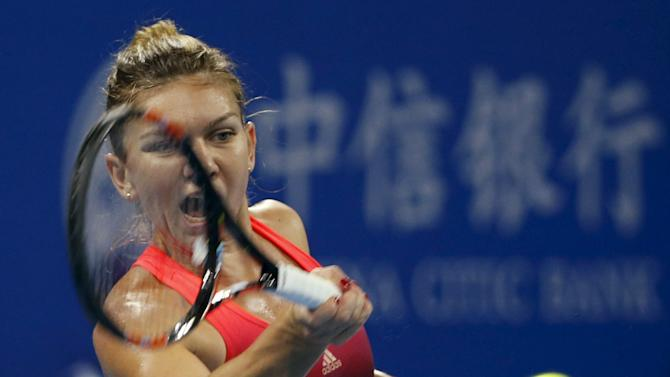 Simona Halep of Romania shots a return against Lara Arruabarrena Vecino of Spain during their women's singles match at the China Open tennis tournament in Beijing