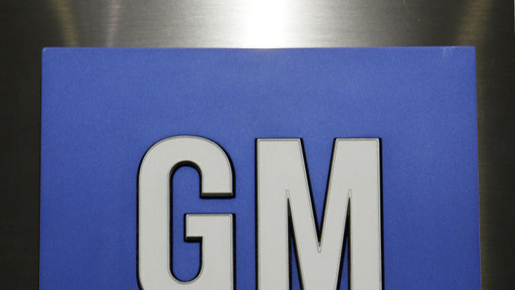 FILE - In this Jan. 25, 2010 file photo, a General Motors Co. logo is shown during a news conference in Detroit. Sunday, Nov. 18, 2012, marks the anniversary of GM's initial public stock offering in November 2010. The company has made money for 11 straight quarters, piling up more than $16 billion in profits. Its cars and trucks are selling for good prices. And sales are strong in China. (AP Photo/Paul Sancya, File)