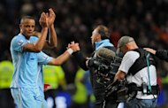 Manchester City's Belgian footballer Vincent Kompany applauds the crowd after beating Manchester United 1-0 during their English Premier League football match at The Etihad stadium in Manchester
