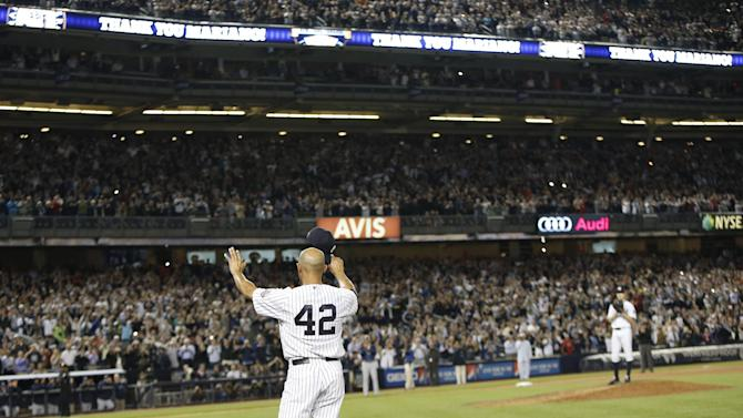 New York Yankees relief pitcher Mariano Rivera (42) tips his cap to the crowd in a curtain call after pitching in the eighth and ninth innings in a baseball game against the Tampa Bay Rays in his final appearance at a baseball game at Yankee Stadium, Thursday, Sept. 26, 2013, in New York. (AP Photo/Kathy Willens)
