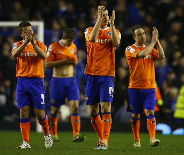 Oldham Athletic's players react after their FA Cup fifth round replay soccer match against Everton at Goodison Park in Liverpool