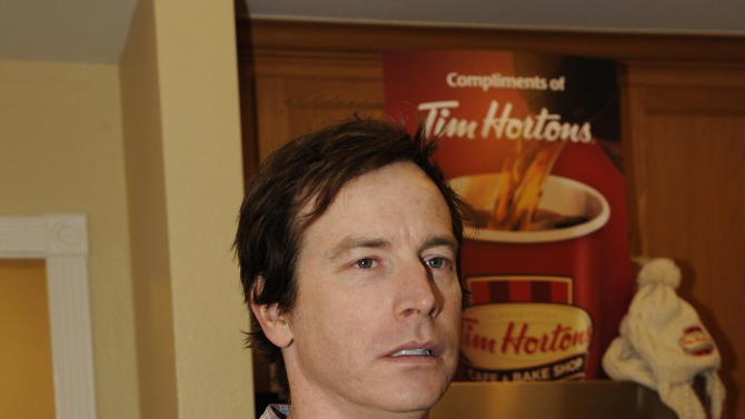 Actor Rob Huebel drinks Tim Hortons cafe & bake shop coffee at the Fender Music lodge during the Sundance Film Festival on Monday, Jan. 21, 2013, in Park City, Utah. (Photo by Jack Dempsey/Invision for Fender/AP Images)