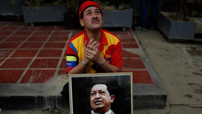 A supporter of Venezuela's late President Hugo Chavez cries outside the military academy where the leader's body had been lying in state, in Caracas, Venezuela, Friday, March 15, 2013. Chavez's body was transferred to the military museum, his final resting place. Venezuelans lined up to bid their last farewell to Hugo Chavez on Friday. Chavez was 58 when he died of an undisclosed type of cancer on March 5. (AP Photo/Ariana Cubillos)