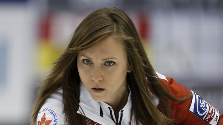 Canada's skip Rachel Homan delivers a stone during her draw against Denmark at the World Women's Curling Championships in St. John