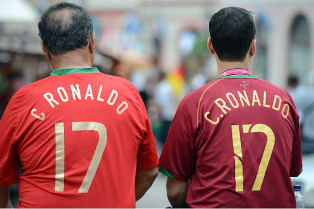 TOPSHOTS Two Fans Of Portugal's National Football Team Wearing Jerseys Of Portuguese Forward Cristiano Ronaldo Wait In  AFP/Getty Images