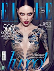 Ooh! Take a look at Coco Rocha looking utterly ravishing on the cover of Elle Brazil's May issue. Her burgundy hair has been pulled into a tight centre parting, her cheeky cheekbones are looking sharper than ever and her ample assets are peeping through a blue sheer dress that could be mistaken