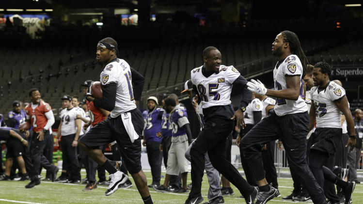 Members of the Baltimore Ravens warm up during an NFL Super Bowl XLVII walkthrough on Saturday, Feb. 2, 2013, in the Mercedes-Benz Superdome in New Orleans. The Ravens face the San Francisco 49ers in Super Bowl XLVII on Sunday. (AP Photo/Patrick Semansky)