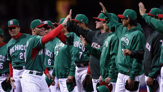 SAN DIEGO - MARCH 15: Scott Hairston #14 of Mexico is high fived by teammates during introductions prior to the start against Korea during the 2009 World Baseball Classic Round 2 Pool 1 match on March 15, 2009 at Petco Park in San Diego, California. (Photo by Donald Miralle/Getty Images)