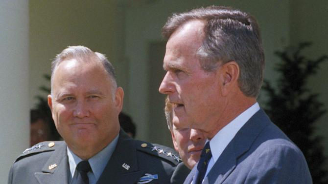 """FILE - In this April 23, 1991 file photo,  Gen. Norman Schwarzkopf, left, looks on as President George Bush speaks to reporters in the White House Rose Garden as in Washington. Bush praised the general for leading a """"fantastic"""" effort to fulfill U.S. obligations in the gulf, and for helping to build """"unbelievable"""" morale on the home front. Schwarzkopf died Thursday, Dec. 27, 2012 in Tampa, Fla. He was 78. (AP Photo/Barry Thumma, File)"""