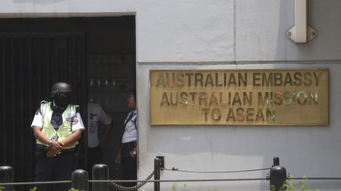 Security officers stand guard at the Australian Embassy in Jakarta, Indonesia, Jakarta, Indonesia, Friday, Nov. 1, 2013. Australia's ambassador met with Indonesian government officials who summoned him Friday following reports the Australian Embassy in Jakarta is a hub for Washington's secret electronic data collection program. (AP Photo/Dita Alangkara)