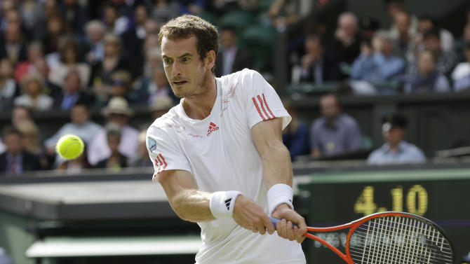 Andy Murray of Britain plays a shot to David Ferrer of Spain during a quarterfinals match at the All England Lawn Tennis Championships at Wimbledon, England, Wednesday July 4, 2012. (AP Photo/Anja Niedringhaus)