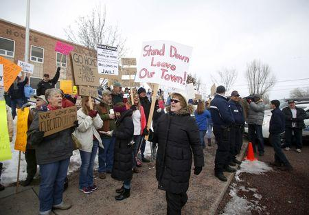 Anti-militia protestors picket outside the Harney County Courthouse in Burns, Oregon
