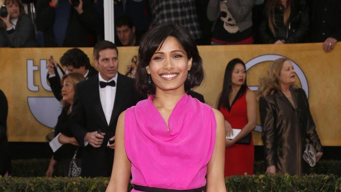Freida Pinto arrives at the 19th Annual Screen Actors Guild Awards at the Shrine Auditorium in Los Angeles on Sunday Jan. 27, 2013. (Photo by Todd Williamson/Invision for The Hollywood Reporter/AP Images)