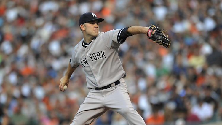 New York Yankees starting pitcher David Phelps delivers against the Baltimore Orioles in the first inning of a baseball game, Saturday, June 29, 2013, in Baltimore. (AP Photo/Gail Burton)