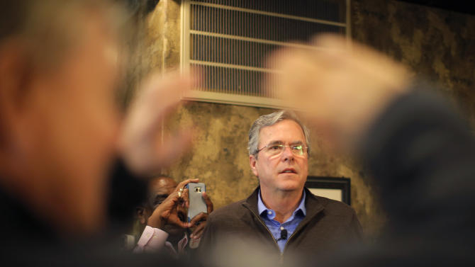 U.S. Republican presidential candidate Jeb Bush waits as he is introduced by U.S. Senator Lindsey Graham during a campaign event in Florence