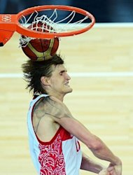 Russian forward Andrei Kirilenko scores against Lithuania during their London 2012 Olympic Games men's quarterfinal basketball match in London. Kirilenko scored 19 points and grabbed 12 rebounds to lead Russia over Lithuania 83-74 and into the semi-finals of the Olympic men's basketball tournament on Wednesday