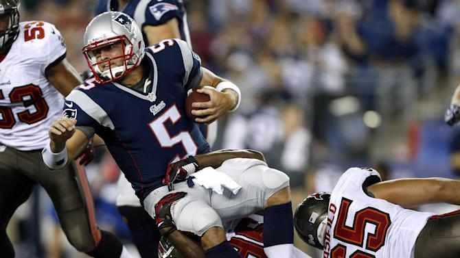 Tampa Bay Buccaneers defensive end Steven Means (96) tackles New England Patriots quarterback Tim Tebow (5) in the third quarter of an NFL preseason football game Friday, Aug. 16, 2013, in Foxborough, Mass. (AP Photo/Michael Dwyer)