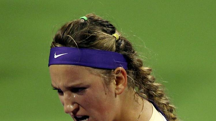 Belarus' Victoria Azarenka celebrates after winning against Sara Errani of Italy in their WTA Qatar Ladies Open tennis quarterfinal match in Doha, Qatar, Friday, Feb. 15, 2013. (AP Photo/Osama Faisal)