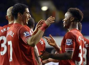 Liverpool's Suarez and Sterling celebrates after scoring a goal during their English Premier League soccer match against Tottenham Hotspur at White Hart Lane in London