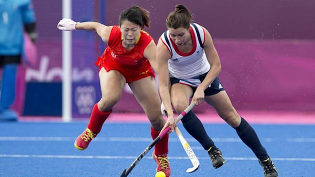 Britain's Kate Walsh and China's Liang Meiyu clash during their preliminary round Group A women's hockey match at the Riverbank Arena during the London 2012 Olympic Games (Reuters)