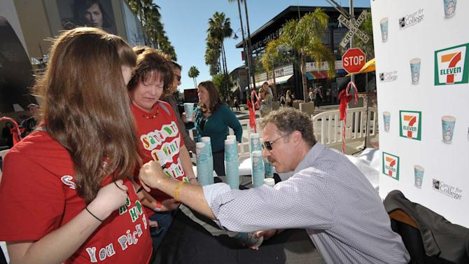 IMAGE DISTRIBUTED FOR 7-ELEVEN - Will Ferrell, right, greets fans at The Grove, where he premiered 7-Eleven's Holiday Cup designed by his son on Tuesday, Nov. 13, 2012 in Los Angeles. (Photo by John Shearer/Invision for 7-Eleven/AP Images)