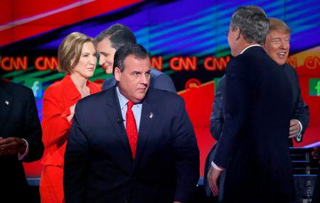 Republican U.S. presidential candidates (L-R) former HP CEO Carly Fiorina, Senator Ted Cruz, Governor Chris Christie, former Governor Jeb Bush and businessman Donald Trump mix and chat at the end of the Republican presidential debate in Las Vegas