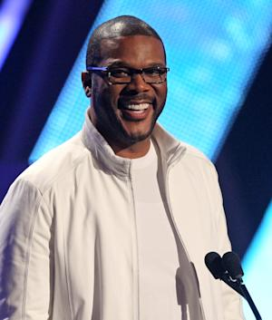 "FILE - In this Sunday, July 1, 2012, file photo, Tyler Perry smiles on stage at the BET Awards, in Los Angeles. Essence is known for honoring black women, but during Oscar week, they'll also be lauding the accomplishments of African-American men in film. The magazine is launching its first ""Black Men in Hollywood"" dinner, an intimate affair that will salute the work of Spike Lee, Lee Daniels, Malcolm Lee and filmmaker Perry, who will host the event. (Photo by Matt Sayles/Invision/AP, File)"