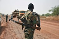A soldier stands guard near the frontline in Lalop, near Bentiu, capital of South Sudan's Unity state. South Sudan has accused Sudan of launching a new air raid on its territory and queried if Khartoum was trying to derail fragile peace talks which resumed recently