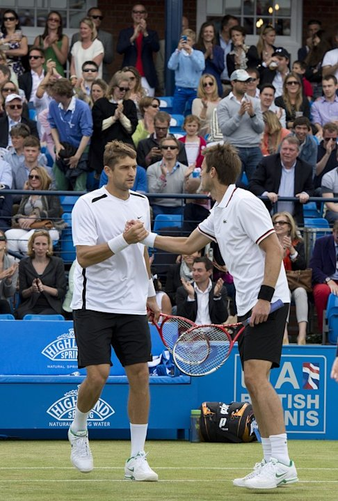 Belorussia's Max Mirnyl (L) Shakes AFP/Getty Images