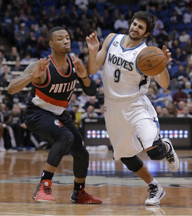 Minnesota Timberwolves guard Ricky Rubio (9), of Spain, drives against Portland Trail Blazers guard Damian Lillard (0) during the fourth quarter of an NBA basketball game in Minneapolis, Wednesday, De