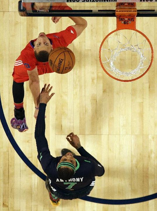 West Team's Stephen Curry, of the Golden State Warriors, left and East Team's Carmelo Anthony, of the New York Knicks (7) watch a ball  during the NBA All Star basketball game, Sunday, Feb. 16
