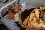 Afghan child bride Sahar Gul, 15, lies in a bed as she recovers at the Wazir Akbar Khan hospital in Kabul on January 12, 2012. Three members of the family of Gul's husband have been jailed for 10 years, an official has said