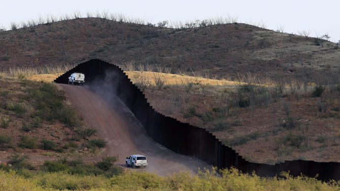 U.S. Border Patrol agents patrol the border fence near where a U.S. Border Patrol agent Nicholas Ivie was shot and killed, and one other was shot and injured, Tuesday, Oct. 2, 2012, in Naco, Ariz. (AP Photo/Ross D. Franklin)