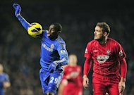 Chelsea striker Demba Ba (L) shields the ball from Southampton defender Jos Hooiveld during the Premier League clash at Stamford Bridge on January 16, 2013. Chelsea led through Ba and Eden Hazard but Southampton recovered through Rickie Lambert and Jason Puncheon