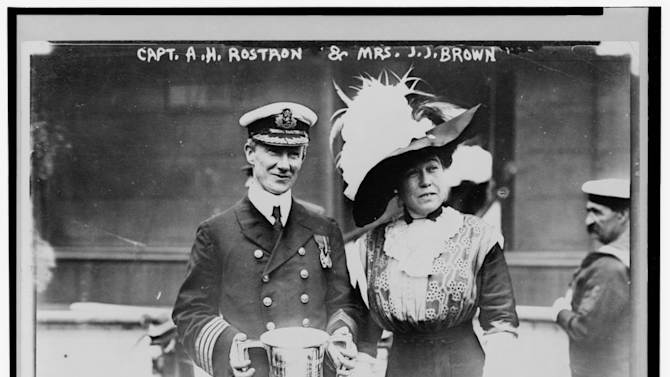 """This May 29, 1912 photograph on display at the Molly Brown Museum shows Mrs. J.J. """"Molly"""" Brown presenting a trophy cup award to Capt. Arthur Henry Rostron for his service in the rescue of the passengers on Titanic that sunk April 15, 1912. (AP Photo/Molly Brown Museum)"""